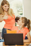 Student and teacher tutor in classroom Stock Images