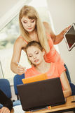Student and teacher tutor in classroom Royalty Free Stock Images