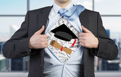 Student is tearing the shirt. Graduation attributes are drawn on the chest. The concept of the graduation. Stock Image
