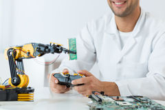Student of technology using a modern robotic arm Royalty Free Stock Image