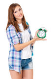 Student teen girl. Beautiful student teen girl with backpack and alarm clock, isolated on white background Royalty Free Stock Photo