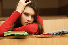Student teen girl beautifyl tired in empty classroom Stock Image
