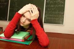 Student teen girl tired in empty classroom Stock Images