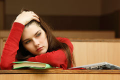 Student teen girl tired in empty classroom university Stock Images