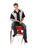 Student: Teen Male Sitting on School Desk. Series with male and female students, isolated on white.  Ready to go to college or university Royalty Free Stock Photo