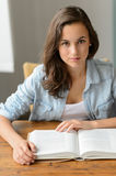 Student teenage girl reading book looking camera Royalty Free Stock Photography
