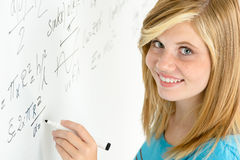 Student teenage girl write mathematics white board Stock Photo