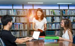Student Teenage Talking, Reading Book, using Laptop Computer. In Library Room Education Classroom with White Isolated Clipping Path Stock Image