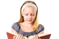 Student teenager girl reading a book isolated Royalty Free Stock Images