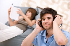 Student - Teenager man relaxing with headphones Royalty Free Stock Images