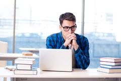 Student in telelearning distance learning concept reading in lib. Rary Royalty Free Stock Photo