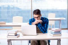 Student in telelearning distance learning concept reading in lib. Rary Stock Images
