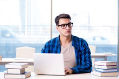 Student in telelearning distance learning concept reading in lib. Rary Royalty Free Stock Photos
