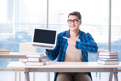 Student in telelearning distance learning concept reading in lib. Rary Royalty Free Stock Image