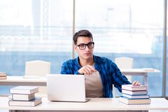 Student in telelearning distance learning concept reading in lib. Rary Royalty Free Stock Images