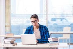 Student in telelearning distance learning concept reading in lib. Rary Stock Photos