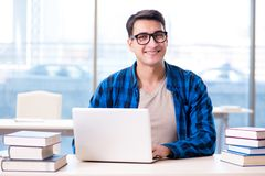 Student in telelearning distance learning concept reading in lib. Rary Royalty Free Stock Photography