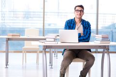 Student in telelearning distance learning concept reading in lib. Rary Stock Image