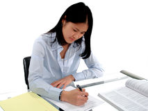 Student Testing. Female student intently concentrating on an English Exam Royalty Free Stock Images