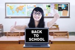 Student with a text of back to school Royalty Free Stock Images