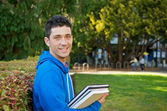 Student with Text book. Male student holding textbooks outdoor Royalty Free Stock Photo