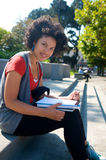 Student with Text book. African American Student girl on campus Royalty Free Stock Photo
