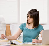 Student with text books doing homework Royalty Free Stock Image