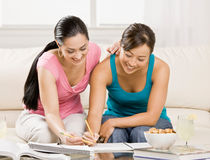 Student with text books helping friend do homework royalty free stock photo