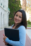 Student with textbook on campus Royalty Free Stock Photo
