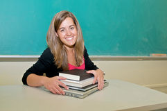 Student with textbook in classroom Royalty Free Stock Photos