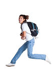 Student with a textbook and satchel. Jumping leaping or celebrating a success, triumph or other. White background Royalty Free Stock Photo