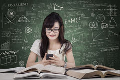 Student texting in the class Royalty Free Stock Images
