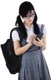 A student is texting on mobile phone Stock Photo