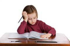 Student thinking. Girl at a school desk, isolated on a white background Stock Image