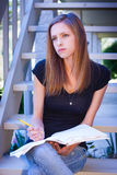 Student thinking with notebook and pencil Stock Photos