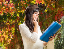 Student thinking and reading on autumn Stock Images