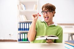 Student throwing dart in education concept royalty free stock photography