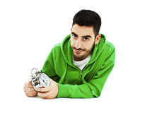 Student tired hold clock, sitting at the desk, handsome young man upset looking at camera Royalty Free Stock Images