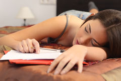 Student tired and sleeping in her room Royalty Free Stock Images