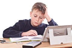 Student to do homework. At a table on a white background royalty free stock photo