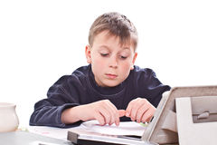 Student to do homework. At a table on a white background royalty free stock image