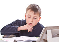 Student to do homework. At a table on a white background stock photos