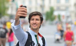 Student / tourist taking self portrait Stock Image