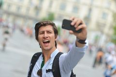 Student / tourist taking self portrait Stock Photography