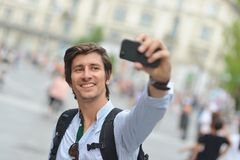 Student / tourist taking self portrait Stock Images