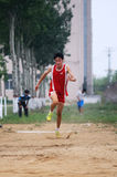 Student Track and Field Games/ The triple jump royalty free stock image