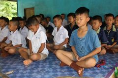 Student is training the concentration. UDONTHANI, THAILAND – MAY 16, 2018:  Students,  sit for training the concentrate,  be morality of Buddhism,  that they Royalty Free Stock Photo