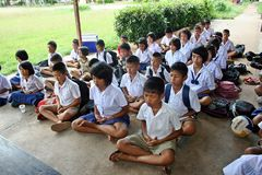 Student is training the concentration. UDONTHANI, THAILAND – MAY 16, 2018:  Students,  sit for training the concentrate,  be morality of Buddhism,  that they Stock Photography