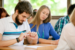 Student transcribed test by colleague Royalty Free Stock Photography
