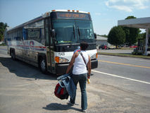 Student Traveler New York USA. Coach USA Bus makes an unscheduled country stop for a traveler headed to New York City royalty free stock photos